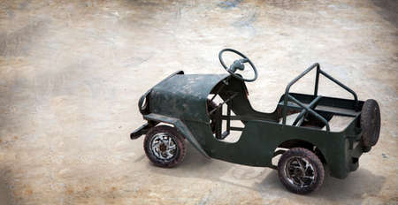 mini car vintage boy toy handmade on outdoor cement in retro style Zdjęcie Seryjne