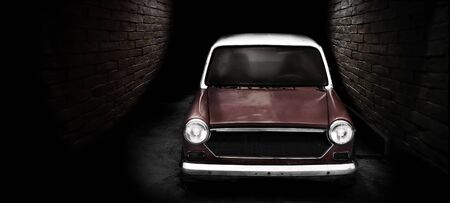 Vintage classic car in dark street in dark background and banner size