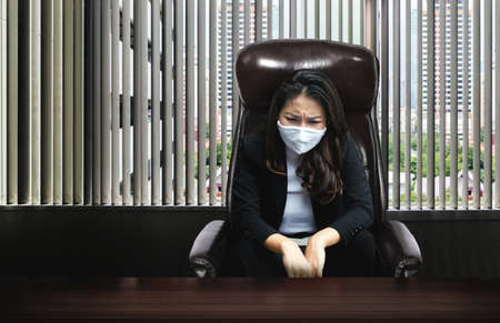 smart asian woman as CEO fails in business and sorrow on working desk with covid-19 coronavirus pandemic Stock fotó