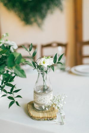 Wedding decorated bottle with flower.