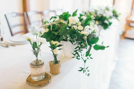 Wedding centerpiece and decorated bottle with flower. Stock Photo
