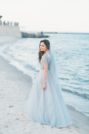 Cheerful bride at the seashore.