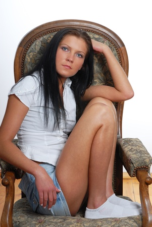 young woman sitting on the chair photo