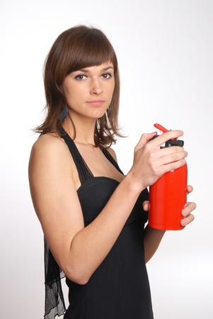 beautiful woman with the fire extinguisher Stock Photo - 11552566