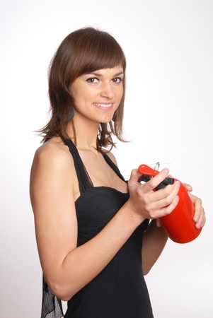 beautiful woman with the fire extinguisher photo