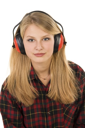 Young happy attractive girl posing in studio . Long-haired beautiful blonde with headphones . photo