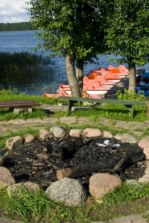 stone  fireplace: Summer in the open air, fireplace surrounded by stone .