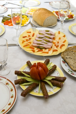 festively: Festively covered table, with various dishes   Stock Photo
