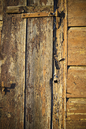 scabrous: Old wall of wooden planks with paint cracked . Stock Photo
