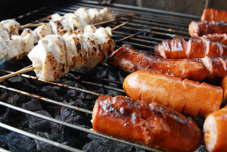 broil: sausage and meat on grill