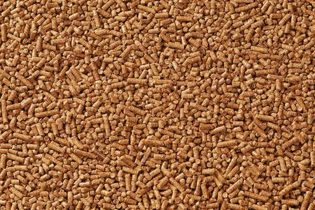 Wood pellets - closeup, background, cheap energy.