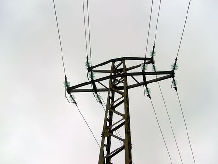 Power pole and lines for high voltage against the autumnal skies photo