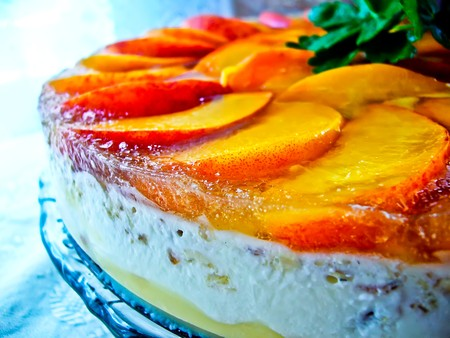 Jellied fruit cake with peach, bisquit and creame without sugar Stock Photo