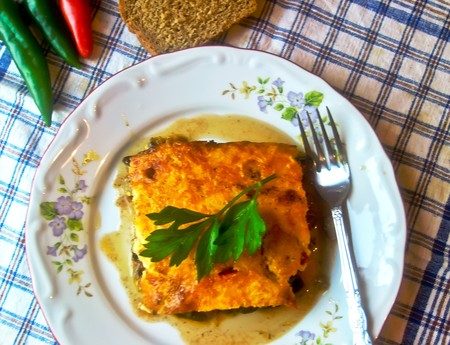 Moussaka of eggplant, tomatoes and minced meat.