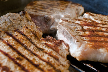 Pork chop grilled with delicious toasted traces and fragrant smoke photo
