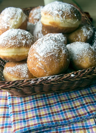 Donuts sprinkled with powdered sugar closeup Stock Photo