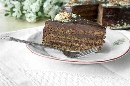 A piece of dark chocolate cake on a plate. Stock Photo