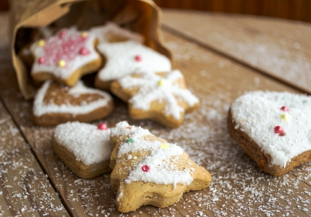 Homemade christmas cookies with decoration on wooden table photo