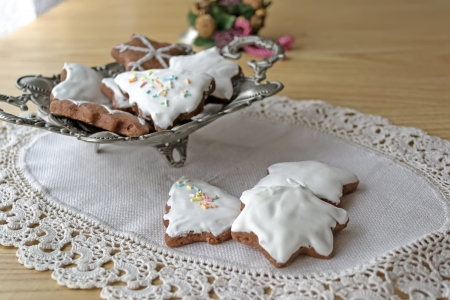 Homemade Christmas cookies in a metal bowl on woven cloth photo