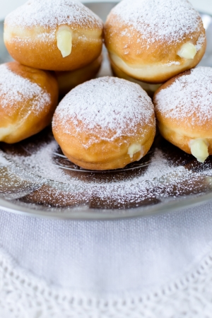 Donuts with cream, sprinkled with powdered sugar Stock Photo