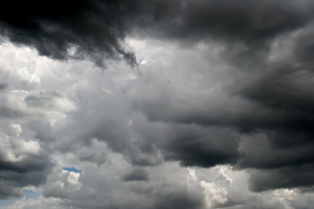 Black storm clouds and blue sky before the rain photo