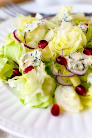Iceberg lettuce with blue cheese and pomegranate seeds photo