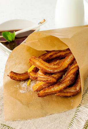 Typical Spanish fried pastry for dessert - churros Stock Photo