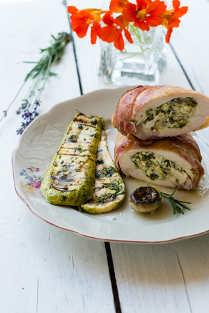 Rolls of chicken breast stuffed with goat cheese and spinach