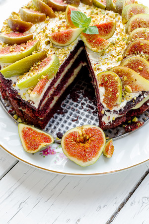 Delicious cake with vanilla cream and garnish with fresh figs