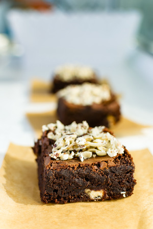 chocolate brownie: Pieces of chocolate brownie with nuts and topped with white chocolate