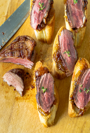 Sandwiches of duck magret, bruschetti and onion confit