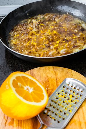 onion peel: Preparation of onion confit with fig jam and orange peel Stock Photo