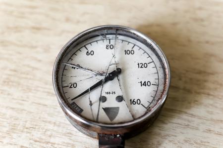 Pressure gauge with a broken glass closeup