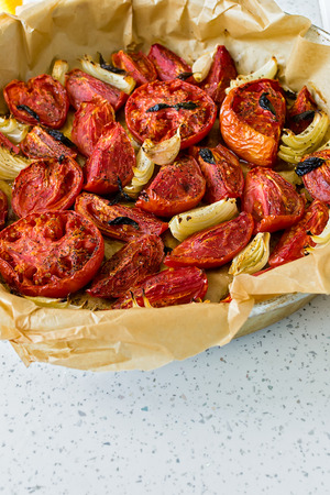 Red tomatoes baked with onions - the basis for tomato soup Stock Photo
