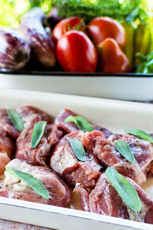 Raw pork with sage and vegetables - before cooking