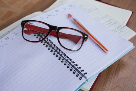 note book: Student note book on wooden table, do homework Stock Photo