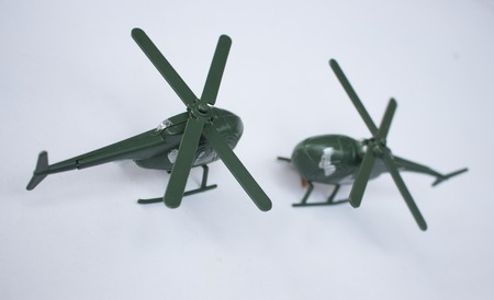 plastic soldier: Toy military helicopter Stock Photo