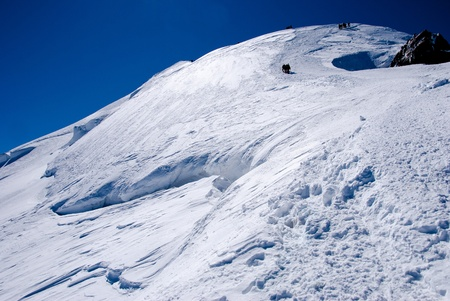 Climbers on glacier. Mont Blanc massif, France.