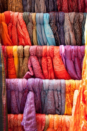 Colorful scarves in a row on market. Indian colors. Market located in Nice, France.