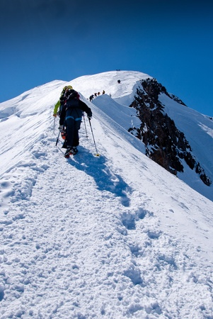 Guided climbers groups on glacier on Mont Blanc massif. France. photo
