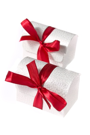 Two white boxes with red ribbons isolated on white background. Christmas present. photo