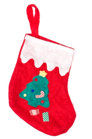 Christmas red sock isolated on white background. Green tree on it.