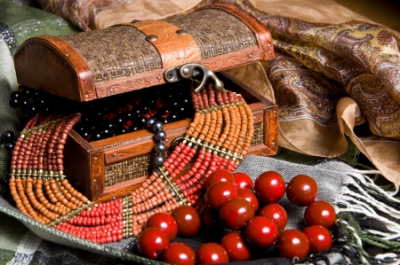 Old jewelery chest with necklaces placed on scarves  Many necklace inside  Stock Photo