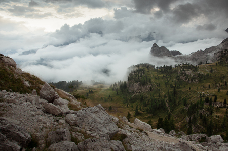 Misty dolomite valley before sunset Editorial
