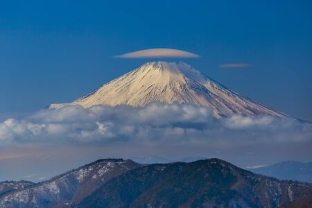 Lenticular cloud on the top of mt. Fuji with Tanzawa range on the foreground Stock Photo