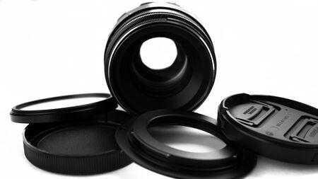 Lens and filters for professional cameras on a white background.