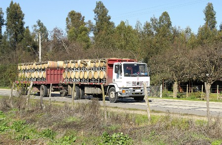 rupestrian: Truck with wine casks in rural route, rupestrian road.                              Stock Photo