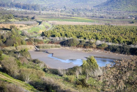 rupestrian: Farm landscape, Bar for irrigation.Small valley in the city of Santiago, chili  Stock Photo