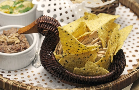 Wicker Basket with food, snacks Before dinner. Stock Photo