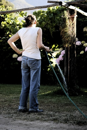 Watering the garden, woman with water